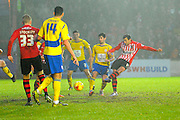 Exeter City's Arron Davies has a shot during the Sky Bet League 2 match between Exeter City and Accrington Stanley at St James' Park, Exeter, England on 23 January 2016. Photo by Graham Hunt.