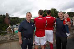 Louis Carey and Liam Fontaine of Bristol City show off the sponsorship of Poplar Insulation with Mike Nolan (left), Blaine Nolan (right) and Riley Nolan (child)  - Photo mandatory by-line: Kieran McManus/JMP - Tel: Mobile: 07966 386802 31/07/2013 - SPORT - FOOTBALL - Avon Gorge Hotel - Clifton Suspension bridge - Bristol -  Team Photo