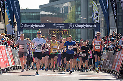 © Licensed to London News Pictures. 13/05/2018. Bristol, UK. Simplyhealth Great Bristol 10k run. 13,000 runners are set to take part. Starting on Anchor Road near Bristol Cathedral, they'll be set off by 2018 Olympic Winter Medallist Dom Parsons, who took home bronze in the skeleton race this January. 30 firefighters are running the Great Bristol 10k this weekend in full fire apparatus while carrying one of their ladders to raise money for three-year-old Daisy Bowyer, who has cerebral palsy and relies on the use of a walking frame and wheelchair. They hope to raise over £20,000 to pay for a private operation that would allow her to walk unaided. The group will run the 10k course with the six-metre long ladder and fire kit, weighing 30kg per firefighter. Photo credit: Simon Chapman/LNP