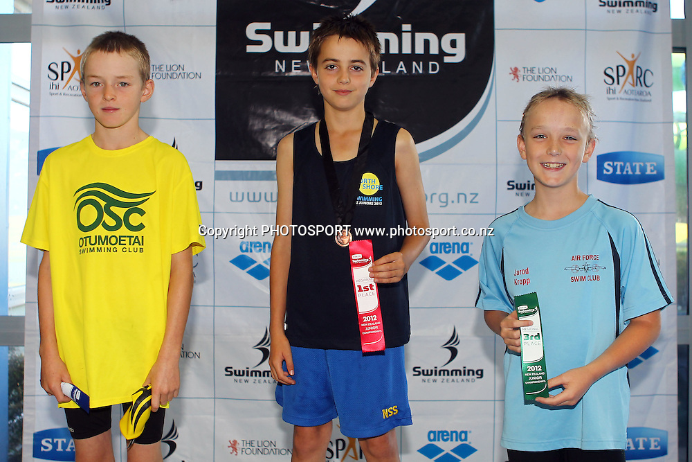 Boys 10 & Under 50 LC Meter Backstroke - Caelan Potts (2nd), Bailey Wang (1st) and Jarod Kropp (3rd). Swimming New Zealand State Junior Championships at Waterworld Te Rapa, Hamilton, New Zealand. Day 2, Sunday 19 February 2012. Photo: Ella Brockelsby / photosport.co.nz