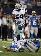 Dallas Cowboys outside linebacker Bruce Carter (54) leaps and celebrates during the NFL week 18 NFC Wild Card postseason football game against the Detroit Lions on Sunday, Jan. 4, 2015 in Arlington, Texas. The Cowboys won the game 24-20. ©Paul Anthony Spinelli