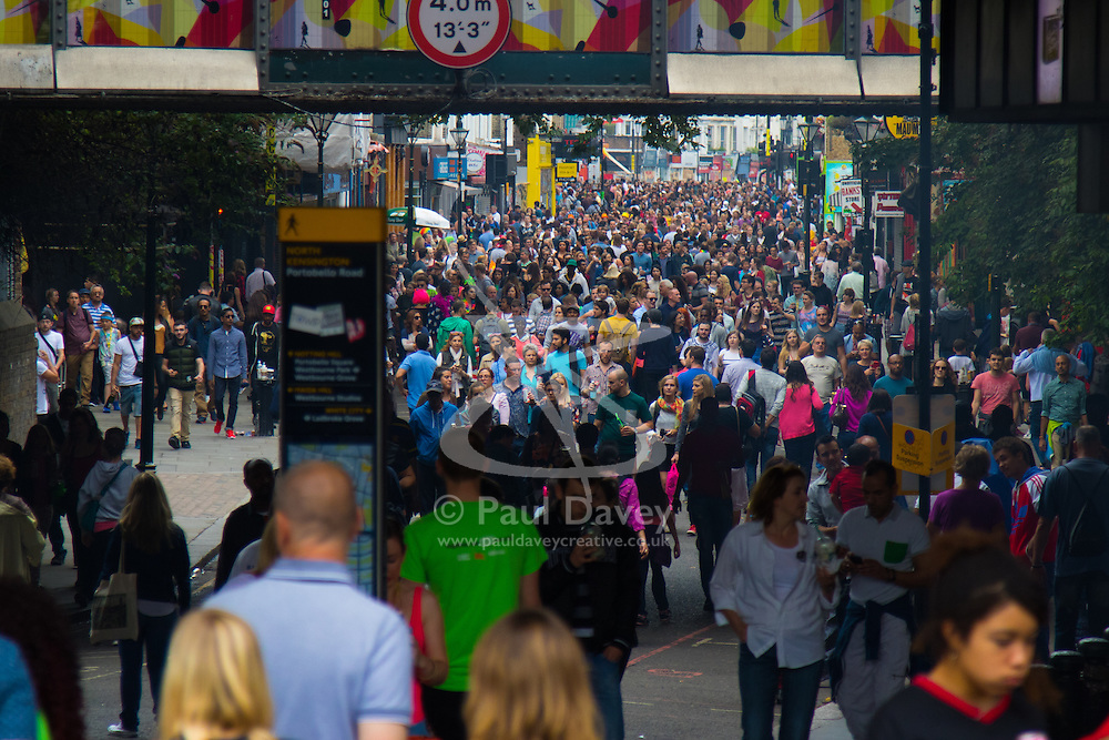 London, August 30th 2015. Thousands of people throng Portobello Road as revellers enjoy Family Day at the Notting Hill Carnival.