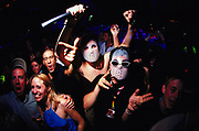 Clubbers wearing masks on the dancefloor Creamfields 2000