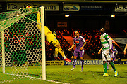 Yeovil Town's Artur Krysiak tips the ball over the bar during the Sky Bet League 2 match between Yeovil Town and Plymouth Argyle at Huish Park, Yeovil, England on 23 February 2016. Photo by Graham Hunt.
