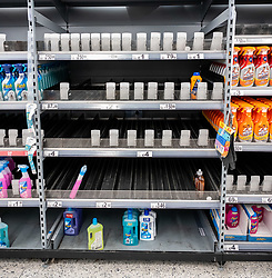 © Licensed to London News Pictures. 05/03/2020. London, UK. Empty shelves on the disinfectant aisle. Panic-buying continues to show in ASDA in South West London as shelves empty out of goods. Prime Minister Boris Johnson appeared on This Morning TV show to reassure the public that the Government is doing all it can to fight the coronavirus disease.. Photo credit: Alex Lentati/LNP