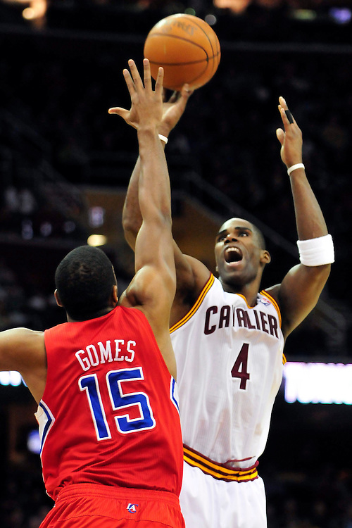 Feb. 11, 2011; Cleveland, OH, USA; Cleveland Cavaliers power forward Antawn Jamison (4) shoots over Los Angeles Clippers small forward Ryan Gomes (15) during the second quarter at Quicken Loans Arena. Mandatory Credit: Jason Miller-US PRESSWIRE