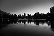 New York. Manhattan.  skyline of Central park south skyscrapers and the lake   / la ligne des gratte ciel de central park south et le lac  New York