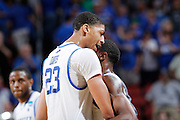 Anthony Davis #23 of the Kentucky Wildcats hugs teammate Marquis Teague #25 after the game against the Iowa State Cyclones during the third round of the NCAA men's basketball championship on March 17, 2012 at KFC Yum! Center in Louisville, Kentucky. Kentucky advanced with an 87-71 win. (Photo by Joe Robbins)
