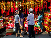 07 FEBRUARY 2018 - BANGKOK, THAILAND: Women shop for Lunar New Year decorations in Bangkok's Chinatown. Lunar New Year, also called Tet or Chinese New Year, is 16 February this year. The coming year will be the Year of the Dog. Thailand has a large Chinese community and Lunar New Year is widely celebrated in Thailand, especially in Bangkok and large cities with significant Chinese communities.      PHOTO BY JACK KURTZ