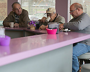 Bill Nassivera, Tony DeSanctis, and Richard Heidt (from left) are among the daily regulars at Ridge Donut Cafe in Irondequoit on Monday, April 20, 2015.