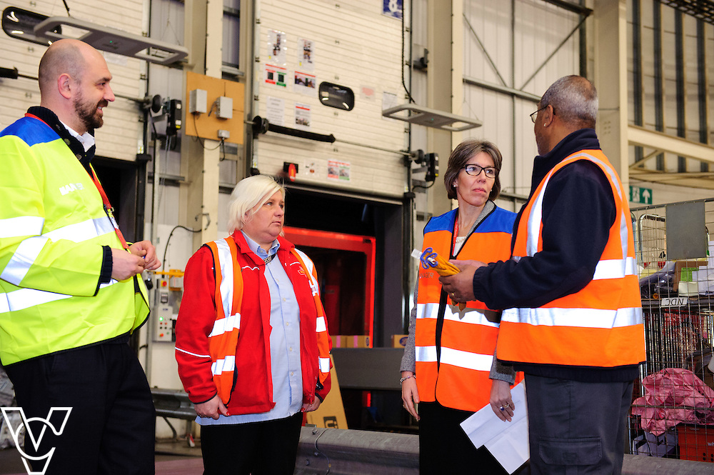 Royal Mail's chief operating officer Sue Whalley, third in from left, talks to, from left, Dave Sykes, Gail Kitchen and Tony Codner  <br /> <br /> The team at the Royal Mail's Yorkshire Delivery Centre have won a lucrative new contract with online retail giants ASOS with the Tracked 48 product.<br /> <br /> Date: December 2, 2015