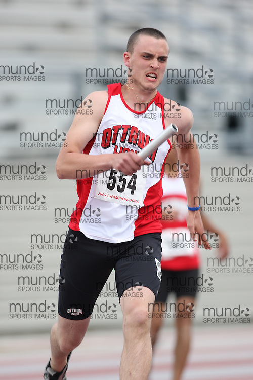 (London, Ontario---14/06/09)   Paul Ausman of Ottawa Lions T.F.C. competes in the  4x200m relay at the 2009 Athletics Ontario Junior Track and Field Championships. The meet was held in London, Ontario from June 13-14, 2009. Copyright photograph Sean Burges / Mundo Sport Images, 2009. www.mundosportimages.com / www.msievents.