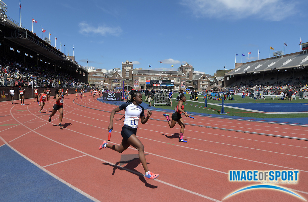 Apr 26, 2018; Philadelphia, PA, USA; General overall view of Danielle Nimako,of Colonie Central (EL) on the third leg of a girls 4 x 100m relay heat during the 124th Penn Relays at Franklin Field.