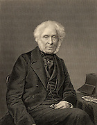 David Brewster (1781-1868) Scottish physicist. Optics (kaleidoscope and polarised light). Editor of the 'Edinburgh Magazine' 1802 and the  'Edinburgh Encyclopaedia' 1808. On the table beside him is a stereoscope, one of the optical instruments he invented.  Engraving, c1870.