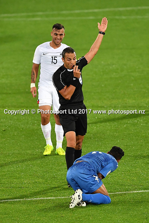 Fiji's Roy Krishna is injured by All Whites' Clayton Lewis who received a yellow card during the New Zealand All Whites v Fiji, FIFA Football World Cup Qualification, OFC Final Group Stage. Westpac Stadium, Wellington, New Zealand. 28 March 2017. Copyright Image: Mark Tantrum / www.photosport.nz