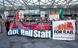 © Licensed to London News Pictures. 02/01/2014. London, UK. Demonstrators, including RMT General Secretary Bob Crow and ASLEF General Secretary Mick Whelan, are seen protesting over today's (02/01/2014) 3.1% rail fare rise outside King's Cross Station in London this morning. The rail fare rise came in to force today as most across the country returned to work for the start of 2014. Photo credit: Matt Cetti-Roberts/LNP