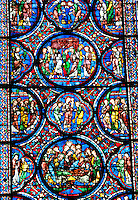 Our Lady of Chartres Cathedral, Chartres, France. Close-up of the detail on a large, lancet  stained glass window, one of many which depict either lives of saints, local laborers, tradesmen and New or Old Testament stories.