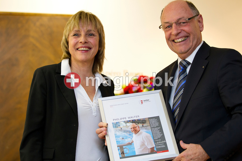 SCUW's president Philippe M. WALTER (R) of Switzerland and town councilor Esther RICKENBACHER are pictured during the award ceremony for the Sportpreis 2011 der Stadt Uster held at the Villa am Aabach in Uster, Switzerland, Friday, Jan. 13, 2012. (Photo by Patrick B. Kraemer / MAGICPBK)
