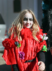 09 February 2016. New Orleans, Louisiana.<br /> Mardi Gras Day. Amelie Szapary in bright and colourful costume in the French Quarter. <br /> Photo©; Charlie Varley/varleypix.com