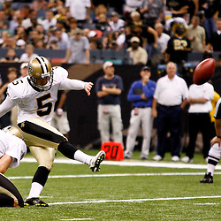August 21, 2010; New Orleans, LA, USA; New Orleans Saints place kicker Garrett Hartley (5) kicks during the first quarter of a preseason game against the Houston Texans at the Louisiana Superdome. Mandatory Credit: Derick E. Hingle