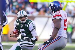 Dec 24, 2011; East Rutherford, NJ, USA; New York Giants defensive end Justin Tuck (91) sacks New York Jets quarterback Mark Sanchez (6) during the first half at MetLife Stadium.