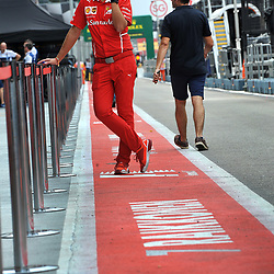 Ferrari mechanic taking a break.<br /> Day 1 of the 2017 Formula 1 Singapore airlines, Singapore Grand Prix, held at The Marina Bay street circuit, Singapore on the 14th September 2017.<br /> Wayne Neal | SportPix.org.uk