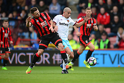 Sofiane Feghouli of West Ham United battles for the ball with Marc Pugh of Bournemouth - Mandatory by-line: Alex James/JMP - 11/03/2017 - FOOTBALL - Vitality Stadium - Bournemouth, England - Bournemouth v West Ham United - Premier League