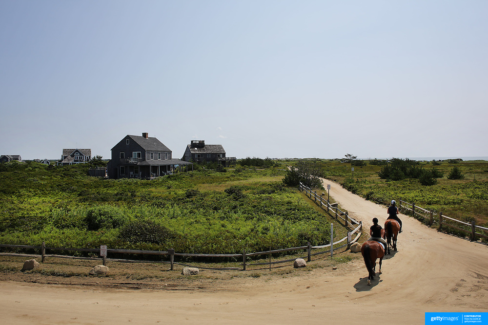 Horse riders head along a track near Cisco Beach, Nantucket, Nantucket Island, Massachusetts, USA. Photo Tim Clayton