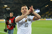 Lukas Podolski of Germany says farewell and applauds the fans during the International Friendly match between Germany and England at Signal Iduna Park, Dortmund, Germany on 22 March 2017. Photo by Phil Duncan.