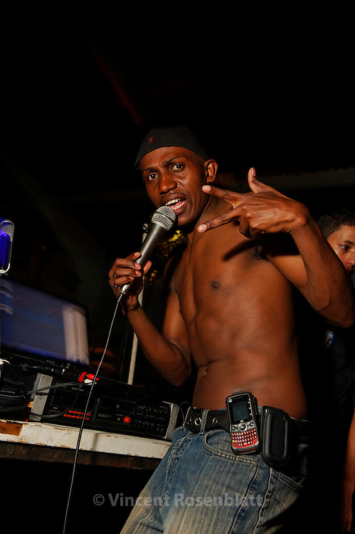 DJ Jones, from the Mensalão soundsystem, performing at the Vizinha Faladeira samba  school, that host Bailes Funk monthly, in the old center of Rioa