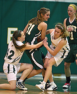 West's McKenzie Piper (31) tries to keep the ball away from Kennedy's Kali Hildebrand (42) and Shauna Happel (40) as teammate Shelly Stumpff (11) looks on during their game at Kennedy High School, 4545 Wenig Rd NE in Cedar Rapids on Tuesday evening, February 8, 2011. Iowa City West defeated Cedar Rapids Kennedy 62-53. (Stephen Mally/Freelance)