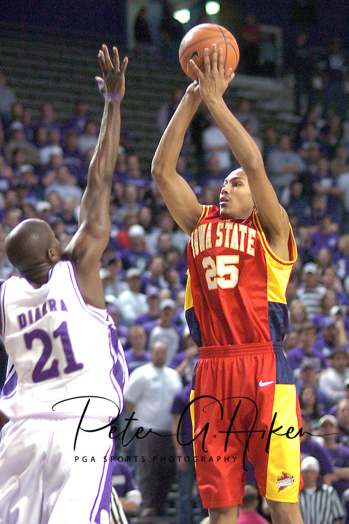 Iowa State forward Jessan Gray (R) puts up a shot over Kansas State's Dramane Diarra (L) in the first half at Bramlage Coliseum in Manhattan, Kansas, February 8, 2006.  K-State defeated the Cyclones 66-63.