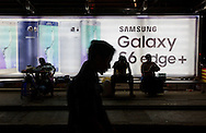 Samsung billboard at bus stop in downtown Yangon, Myanmar on December 15, 2015. (Photo by Kuni Takahashi)