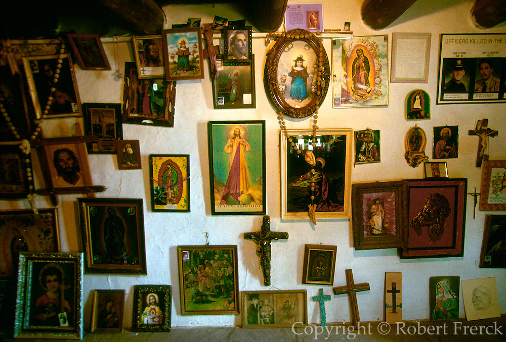 NEW MEXICO, SPANISH MISSIONS Santuario de Chimayo, c1813-16, anteroom w. offerings, gifts and discarded crutches, near Santa Fe