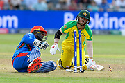 David Warner of Australia turns and dives into his crease to avoid being stumped during the ICC Cricket World Cup 2019 match between Afghanistan and Australia at the Bristol County Ground, Bristol, United Kingdom on 1 June 2019.
