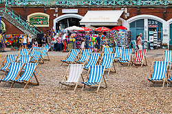 © Licensed to London News Pictures. 21/07/2016. Brighton, UK. Few people can be seen spending time on the beach in Brighton and Hove as grey clouds hang over the seaside resort. Photo credit: Hugo Michiels/LNP
