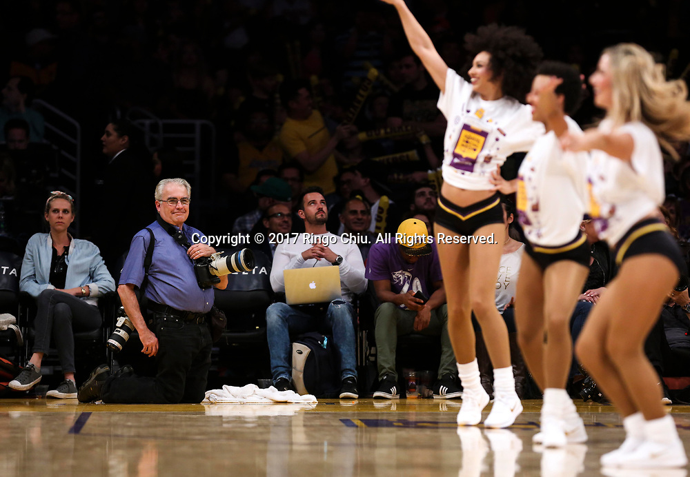 AP photographer Reed Saxon watches the Lakers girls during an NBA basketball game between Los Angeles Lakers and Milwaukee Bucks, Friday, March 17, 2017.(Photo by Ringo Chiu/PHOTOFORMULA.com)<br /> <br /> Usage Notes: This content is intended for editorial use only. For other uses, additional clearances may be required.