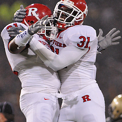 Oct 23, 2009; West Point, N.Y., USA; Rutgers defensive tackle Justin Francis (91) celebrates his fumble recovery with defensive end George Johnson (31) during Rutgers' 27 - 10 victory over Army at Michie Stadium.