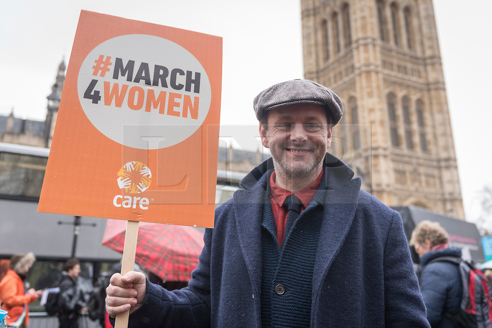 © Licensed to London News Pictures. 04/03/2018. LONDON, UK.  Michael Sheen, actor, joins the march. Hundreds of men and women take part in the annual March 4 Women campaigning for gender equality.  The walk through central London from Millbank to Trafalgar Square retraces the steps of Suffragette's ahead of International Women's Day on 8 March.  Photo credit: Stephen Chung/LNP