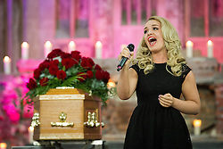 "© Licensed to London News Pictures . 14/10/2013 . Gorton Monastery , Manchester , UK . Singer "" EDEN "" performs . The Humanist funeral of photographer Harry Goodwin , attended by footballers and other celibrities and featuring music by artists he had photographed including ""He Ain't Heavy, He's My Brother"" by the Hollies and "" Happiness "" by Ken Dodd . Photo credit : Joel Goodman/LNP"