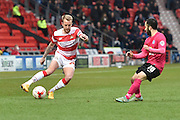 James Coppinger (26) of Doncaster Rovers  up against Erhun oztumer (10) of Peterborough United  during the Sky Bet League 1 match between Doncaster Rovers and Peterborough United at the Keepmoat Stadium, Doncaster, England on 19 March 2016. Photo by Ian Lyall.