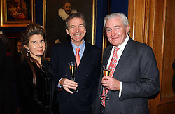 Left to right, MR & MRS CLIVE ASLET he is Editor of Country Life and EARL OF LEICESTER at a reception hosted by Brian Ivory Chairman of the Trustees of The National Galleries of Scotland to commemorate Sir Timothy Clifford's 21 years of Director of the National Gallery of Scotland and his forthcoming retirement in January 2006, held at Christie's, King Street, London W1 on 6th December 2005.<br />