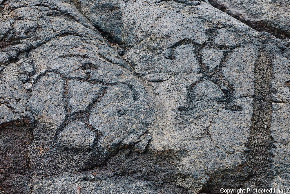 A set of two petroglyphs on the lava rock at Hawaii Volcano National Park.