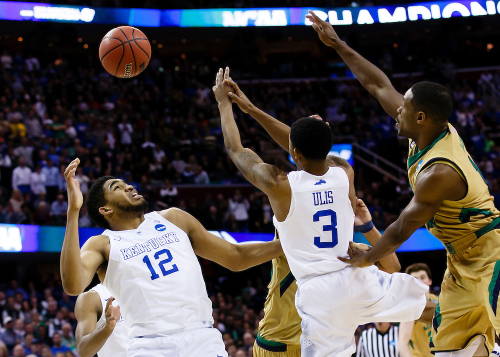 Mar 28, 2015; Cleveland, OH, USA; Kentucky Wildcats forward Karl-Anthony Towns (12) guard Tyler Ulis (3) and Notre Dame Fighting Irish guard Demetrius Jackson (11) goes for the rebound in the finals of the midwest regional of the 2015 NCAA Tournament at Quicken Loans Arena. Mandatory Credit: Rick Osentoski-USA TODAY Sports