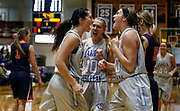 Dakota Wesleyan's Chesney Nagel (32) celebrates a basket and foul with teammates Rylie Osthus (10) and Ashley Bray (20) during a Great Plains Athletic Conference game against Midland University on Sunday at the Corn Palace. (Matt Gade / Republic)