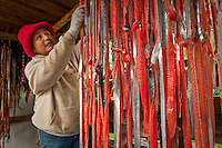 Mae Syvrud processing subsistence caught salmon at her home in Dillingham, AK