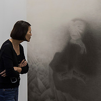 Visitor looks at artist Shao Fan's 'Ape Watching Waves, 2016' at Art Basel Hong Kong 2017 on 23 March 2017, in Hong Kong Convention and Exhibition Centre, Hong Kong, China. Photo by Chris Wong / studioEAST