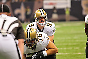 New orleans Saints QB Drew Brees calls out the play at the line of scrimmage during the game against the Atlanta Falcons. New Orlenas Sainst (k) kicker Garrett Hartley (5) kicks a field  goal to tie the game and seend it to OT against the Atlanta Falcons, then misses a field goal in OT and teh Falcons went on to win 27-24.The Super Bowl Champions New Orleans Saints play the Atlanta Falcons Sunday Sept 26, 2010 in New Orleans at the Super Dome in Louisiana.  The Saints and Falcons are tied at half time and went into overtime tied 24-24. Hartley missed a kick to win in overtime., the Atlanta Falcons went on to win on OT with a field goal 27-24. PHOTO©SuziAltman.com
