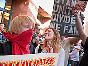 14 OCTOBER 2011 - PHOENIX, AZ:   Protesters in front of the Bank of America in Phoenix during the Occupy Phoenix march. About 300 people participated in the Occupy Phoenix march through downtown Phoenix Friday evening, Oct. 14. The march was the first event in the Occupy Phoenix protests which start with the occupation of Cesar Chavez Plaza, a large square in downtown Phoenix.  PHOTO BY JACK KURTZ