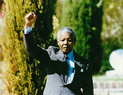 Jan. 1, 1992 - Stockholm, Sweden - NELSON MANDELA raises a proud right fist salute to Swedish crowd, in the air, during a 1992 visit to Sweden. (Credit Image: © Aftonbladet/IBL/ZUMAPRESS.com)
